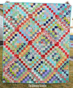 Great colors! Scrappy Trip Around the World Quilt #freequiltpattern