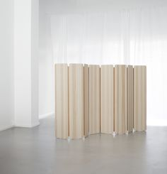 SKANDINAVIA SEPARAT by Cecilie Manz  Photo credit: Cecilie Manz Studio  Wall divider made of pine or ash and naturally tanned leather