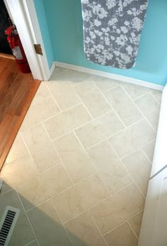 Kitchen cabinets reviews: {DIY} Herringbone Tile Floor. Love the way herringbone looks in a larger tile. Also looks great with the hardwood floors!