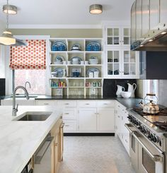 Kitchen with open and closed storage ideas.| Taylor Interior Design