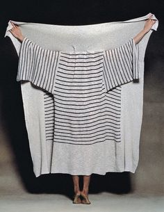From tumblr Issey Miyake  looks like a blanket with sleeves, so clever