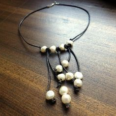 """$60 Ask any southern girl, and she'll tell you... pearls go with everything! Our Cowlicks and Kudzu Lightning bug freshwater pearl and leather necklace goes perfectly with anything from a cute dress to jeans and a t-shirt. Each pearl is hand knotted on the leather in our facility in Griffin, GA. 16"""" - See more at: http://www.morgan-company.com/product.cfm?p=3853&c=47&page=cowlicks-and-kudzu-lightning-bug-pearl-and-leather-necklace#sthash.LfJi3L6R.dpuf"""