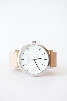 The Horse Leather Watch - White Face, Light Tan Leather Band A simple take on the classic time-teller. Featuring a polished steel case, white face with minimalist markers and light tan leather band. T