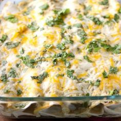 It's so simple to make this chicken enchiladas recipe with salsa verde, chicken, sour cream, cheese and cilantro. A quick and easy dinner.