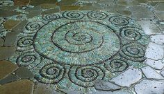 This Pebble mosaic was made with green and black pebbles and iridescent glass marbles. (Patio or stepping stone idea)