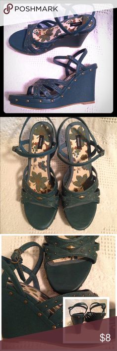 """Wedge sandals Very cool color of dark green with metal grommet details. Worn only one time but they've been sitting in my room for 10 yrs and the threads on the straps have frayed, slightly (as pictured) 4 1/2"""" heel. Xhilaration Shoes Wedges"""