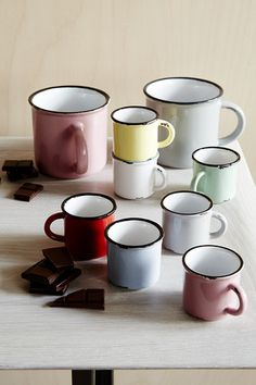 Vintage-Inspired Glazed Stoneware Mimicking vintage metalware, the canvas Tinware grouping is made of stoneware, complete with realistic distressed edges and a contrasting rim stripe. Because of the p