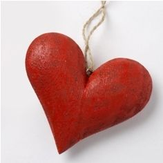 Red Wooden Carved Heart    This deep red heart on thin twine can be hung anywhere for a touch of shabby chic romance!    Av ailable in 2 sizes    Length when hanging:    Small Height Size  7cm    Large When Hanging 17cm