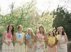 Playful mismatched bridesmaid dress | http://www.weddingpartyapp.com/blog/2014/11/12/unbelievably-fun-printed-bridesmaid-dresses/