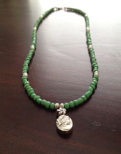Jade green and silver beaded necklace with silver cameo pendant. on Etsy, $15.00
