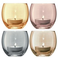 £22.50- Polka Tea Light Holders. Soft, flickering candlelight creates a warm illuminating glow and adds a cosy atmosphere whatever the time of year.  This set of Polka glass tea light holders by LSA includes four vintage-inspired pastel colours, each one carefully hand painted with a delicate metallic lustre. #candle #pastel