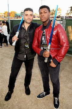 Oscar Isaac and John Boyega at a surprise 'Star Wars' Fan Concert performed by the San Diego Symphony, featuring the classic 'Star Wars' music of composer John Williams, at the Embarcadero Marina Park South on July 10, 2015 in San Diego, California.