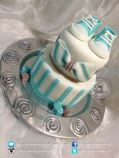 Nameless Baby - His mother is a cancer survivor, and she already has a special baby, so she does not want name him until he is born. This is a very simple cake with a lovely bow as main decoration and sugar baby shoes on top. Original design: Cake Ink. (Janelle)