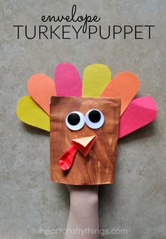 Adorable Envelope Turkey Puppet Craft that kids of all ages can enjoy making for Thanksgiving.