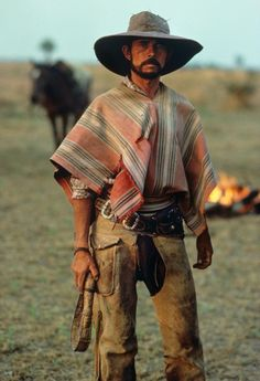 A Gaucho stands with pride, Chaco, Paraguay. The Paraguayan Chaco or Región Occidental is a semi-arid region, with a very low population density. The area is being rapidly deforested. Photo by Steve McCurry