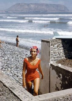 """Mary Ann """"Esqui"""" Graña, one of Lima's beauties, diplomat's daughter, water-skiing champion and Miss Peru 1953, photo by Dmitri Kessel, Ancón, Peru, 1961"""