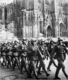 A parade of German soldiers marching past St. Stephen's Cathedral in Vienna, upon the annexation of Austria to the Reich