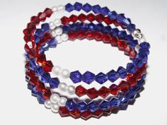 Multi layered memory wire bracelet in red, white and blue Swarovski crystals and faux pearls. Memory Wire Bracelets, Handmade Bracelets, Jewelry Crafts, Swarovski Crystals, Craft Projects, Pearls, Red, Blue, Ideas