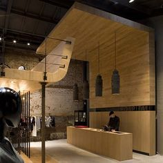 Belgian designers Puresang have designed Hospital, a clothing store set in a former stable in Antwerp.