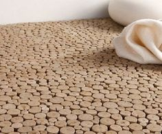 Driftwood floor tile made from sustainable wood.