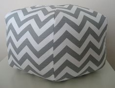 ottoman for baby girl's room and prop for newborn pics. buying the fabric online and using Amy Butler's gumdrop pillow sewing pattern.