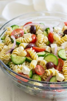 Easy Greek Pasta Salad [+ Video] - Oh Sweet Basil A fresh and easy Greek Pasta Salad just in time for summer! This crowd-pleasing side dish is tasty with grilled meats and at all your backyard barbecues.