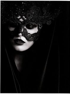 Lace embroidery mask. Black and white photography model