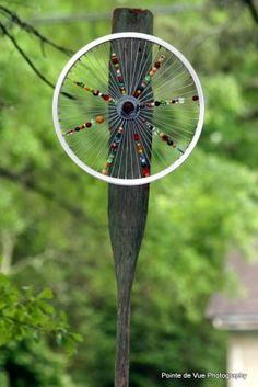 old boat oar, bicycle rim, beads......  so whimsical