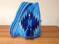 This bag is made with tapestry crochet. You crochet through back loop only.