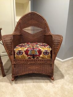Antique Wicker Chair With Re Covered Cushion.
