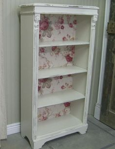 A great touch to a simple bookcase by adding lovey wallpaper or scrap booking paper