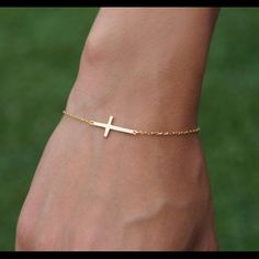 18K Gold Plated Celebrity Style Cross Bracelet. Brand New 18K Gold Plated Celebrity Style Small Sideways Cross Bracelet. Cross length: 0.8 inches. Bracelet Length 6 - 8 inches. Wear it with any outfit. Jewelry Bracelets