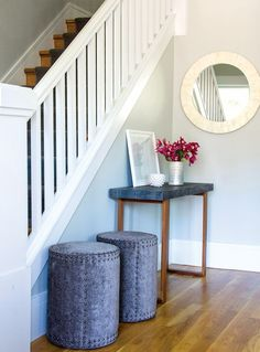 Details of entryway // elegant stools, slate console table, pink flowers, round mirror and small dish