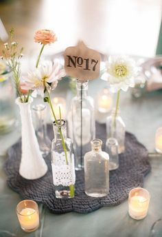 wedding table numbers, love the collection of vases!