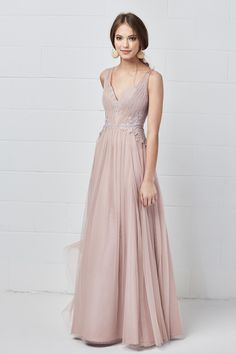 9578f2e295 Style 5602 from Harlynn Watters is a sleeveless floor length Aria Lace and  bobbinet bridesmaid dress with a V neckline and gathered skirt.