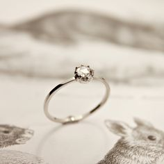 "rose-cut diamond ring... I love the simplicity and historical feel of this ring. The ""rose cut"" goes back to the 1400s, and is very beautiful in my opinion."