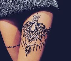 Womens thigh tattoo