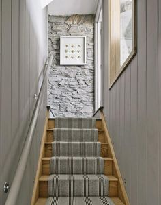 Roger Oates Shetland Wool runner sits perfectly with the stone wall and soft grey tones to create a warm and inviting staircase.