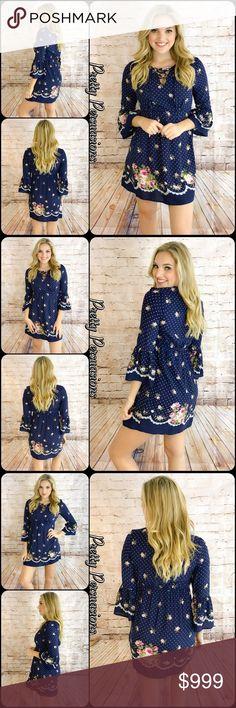 "Navy & Floral Printed Bell Sleeve Lace Up Dress NWT Navy & Floral Printed Bell Sleeve Lace Up Dress  Available in S, M, L, XL Measurements taken from a small  Length: 34"" Bust: 34"" Waist: 28""  Rayon  Features  • lace up neckline  • bell sleeves  • all over floral & polkadot print • soft, breathable material  • cinched waistline   Bundle discounts available  No pp or trades  Item # 1/102100360FPD floral print polka dot tunic dress bell sleeves lace up navy blue white multicolored pretty…"