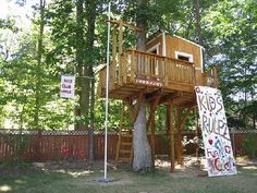 Kids tree house with climbing wall and sliding pole. Love it but this may be more than we can accomplish!