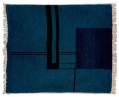 Eileen Gray (1879-1976)  Tapis rectangulaire, vers 1923  En laine au point noué, à motifs géométriques bleu nuit et noirs sur un fond chiné dans des tons de bleus, la bordure frangée le long de deux côtés 154 x 128 cm. (60½ x 50 3/8 in.)  A handwoven wool carpet, the rectangular field knotted in shades midnight-blue and black, by Eileen Gray, circa 1923