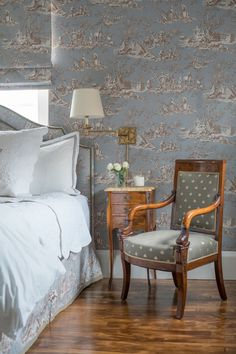 A country blue and brown toile wallpaper plays up the space's traditional New England style.