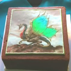 If the dragon cake sculpture is too difficult, A printed picture like this would work. A nice, pre raphaelite painting would work nicely...
