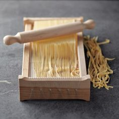 beautifully crafted tool originated in abruzzo, italy, more than a century ago. it produces homemade noodles the traditional wayby pressing rolled sheets of pasta dough against tightly strung wires reminiscent of the strings of a chitarra, or guitar. Italian Pasta, Italian Cooking, Italian Recipes, Wine Recipes, Gourmet Recipes, Pasta Recipes, Cooking Recipes, Pasta Machine, Pasta Maker