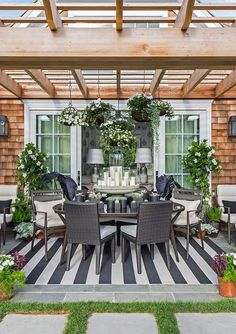 Add a pop of pattern to your outdoor dining space with a bold black & white cabana striped rug.