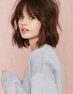 Blunt cut brown bob with messy fringe