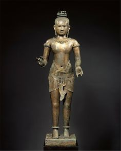 Standing Shiva (?) Angkor period, 11th c. Gilt copper alloy, silver inlay.