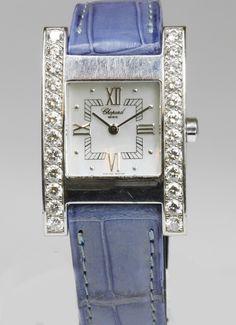 CHOPARD watch. 18K WG housing, occupied m. 24-diam. first international TW 1.94 cts / if (flawless).  Mother-Ziffeblatt. Quartz movement (battery new). Light blue leather strap (v. Cartier) m. Original pin buckle, 18K WG. Purchase in 2001 Juw. Wempe, certificate attached. * Leg. 750/000 - Price: 7.100 EUR