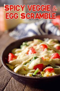 Spicy Veggie & Egg Scramble are a light and healthy breakfast full of spicy chipotle flavor, a creamy avocado sauce and fresh vegetables! #Eggs #Breakfast #Spicy #Chipotle #Healthy