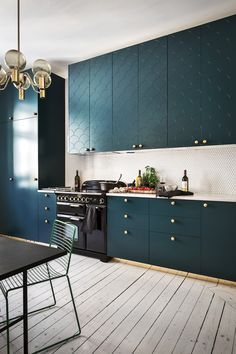 Dark green cabinets.